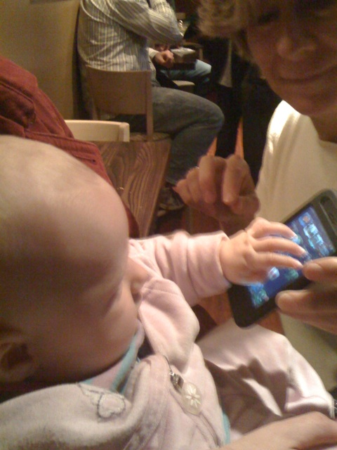 baby Linnea with iphone